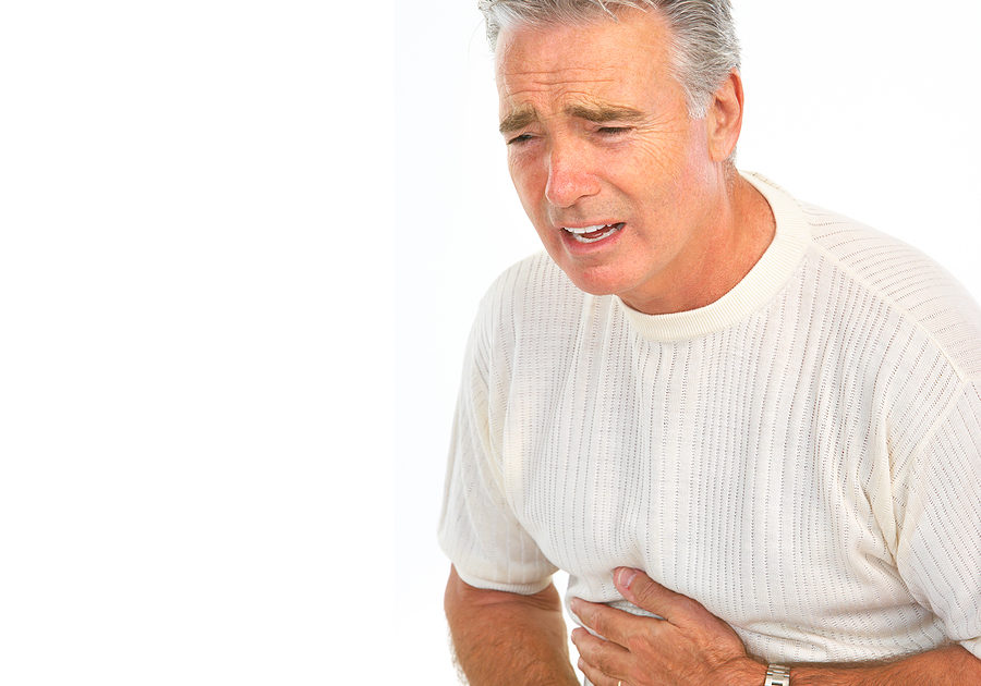 man having stomach pain. Isolated over white background
